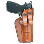 Leather IWB (inside the waistband) holster with reinforced mouth and leather belt loops.